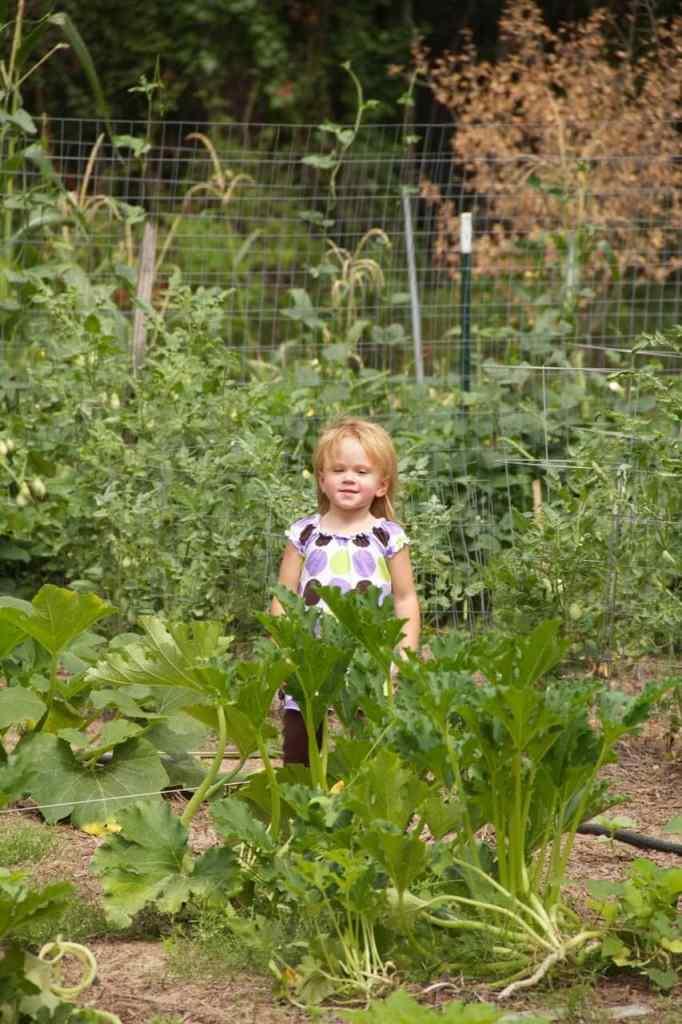 Stacy's daughter posing in the garden