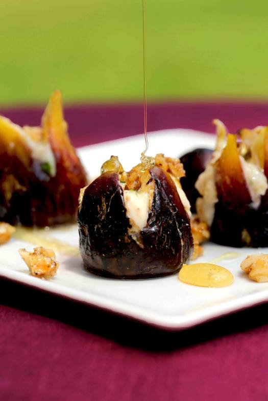 Stuffed figs baked with honey mascarpone cheese filling drizzled with honey