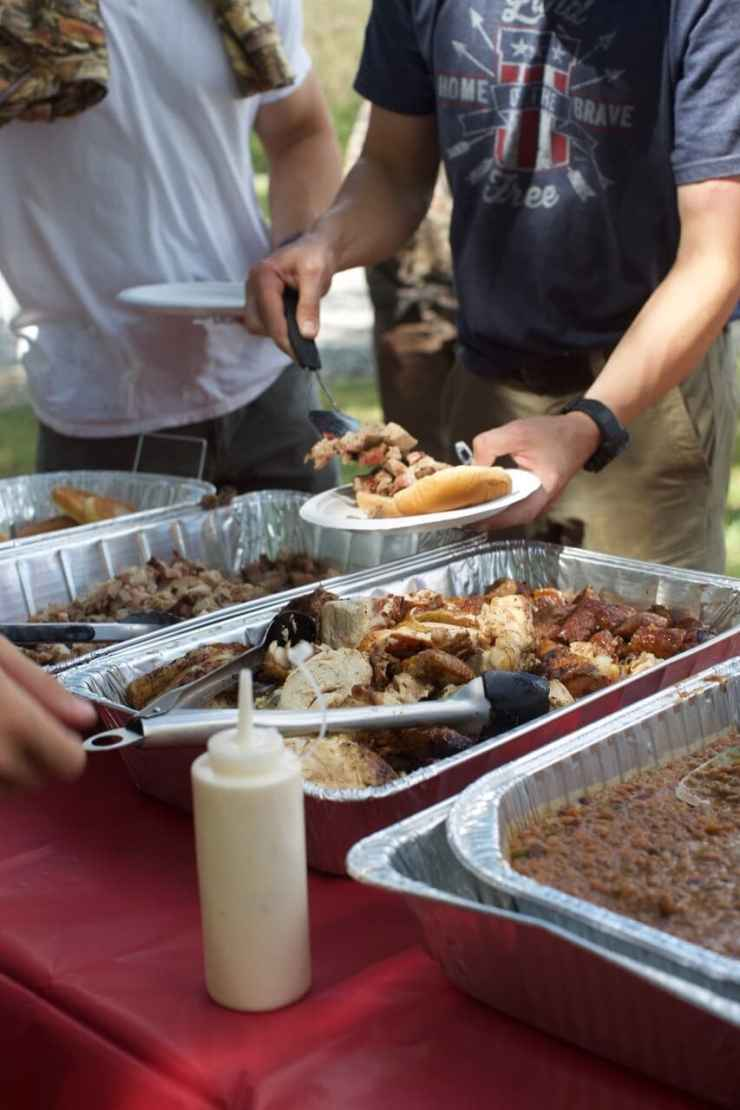 The spread of food served at the dovehunt with participants and spectators digging in