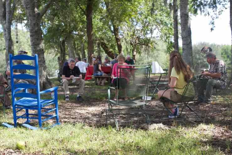 Various participants and spectators of the dove hunt eating together