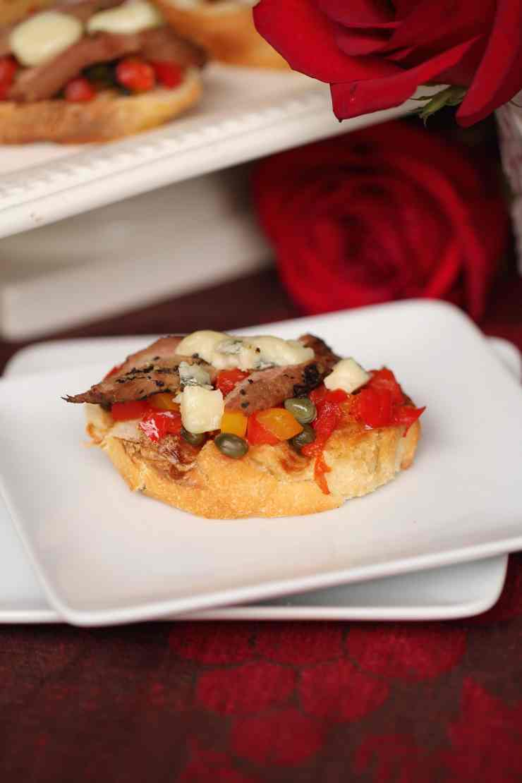 Bruschetta hors d'oeuvres with mediteranean ingredients plus venison