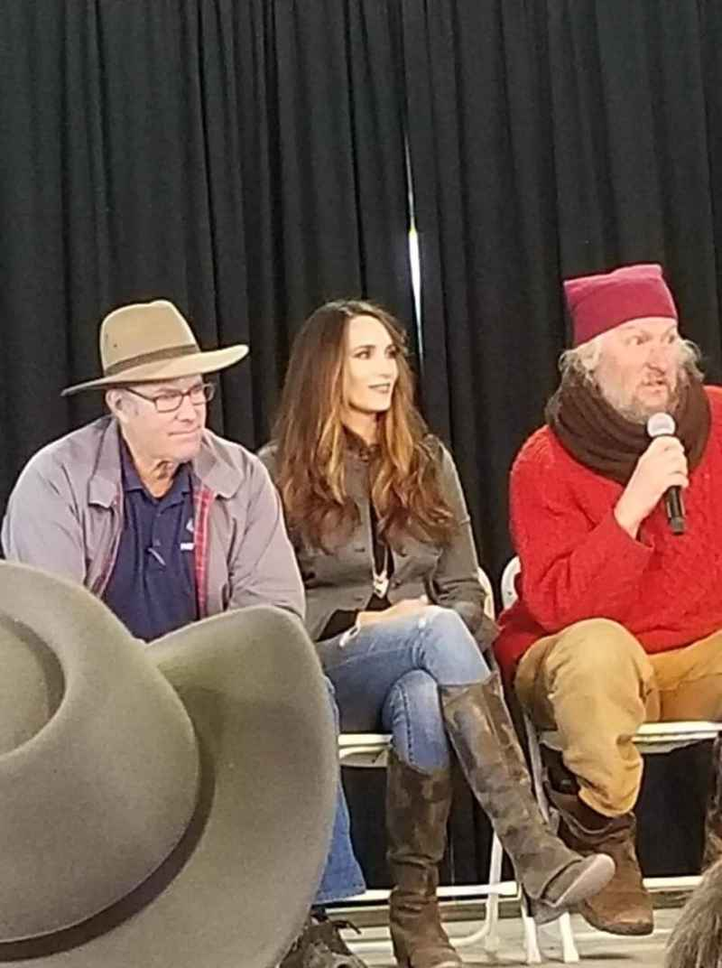 Stacy Lyn Harris seated between Joel Salatin and Eustace Conway on the Q&A panel at the 2018 Homesteaders of America Conference