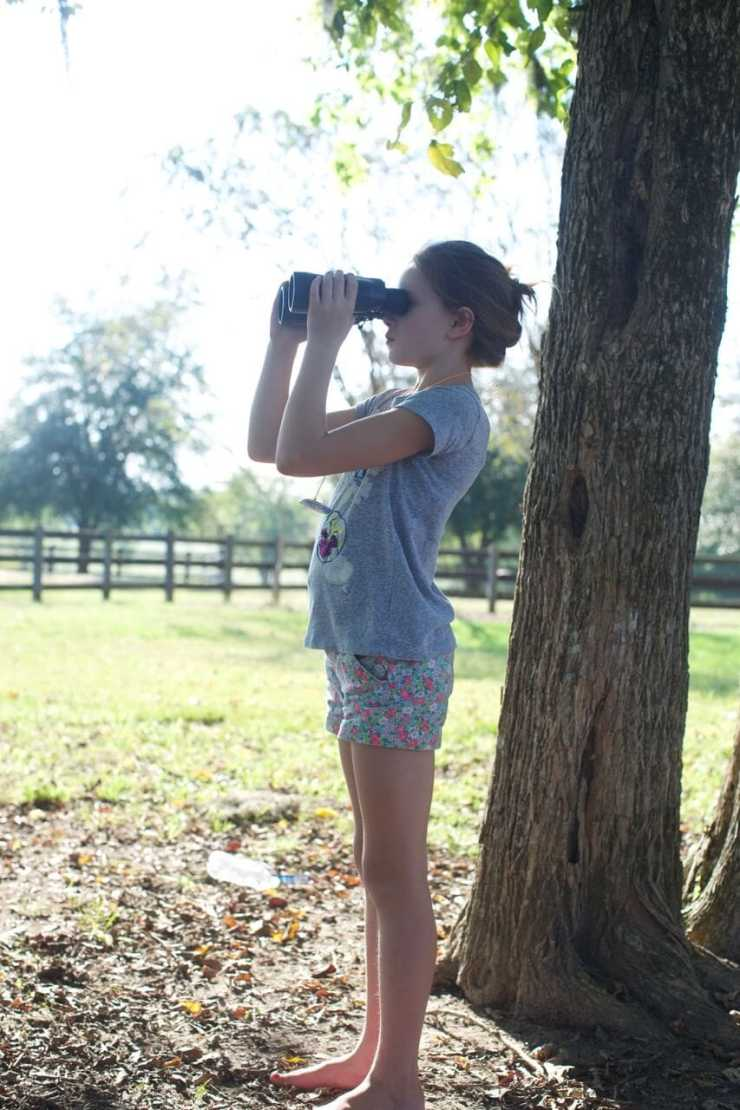 Stacy Lyn's youngest child, Millie, observing the dove hunt from afar with binoculars