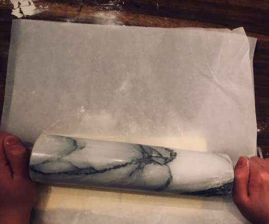 Roll the butter into a flat sheet (recipe for how to make danish pastries by Stacy Lyn Harris)