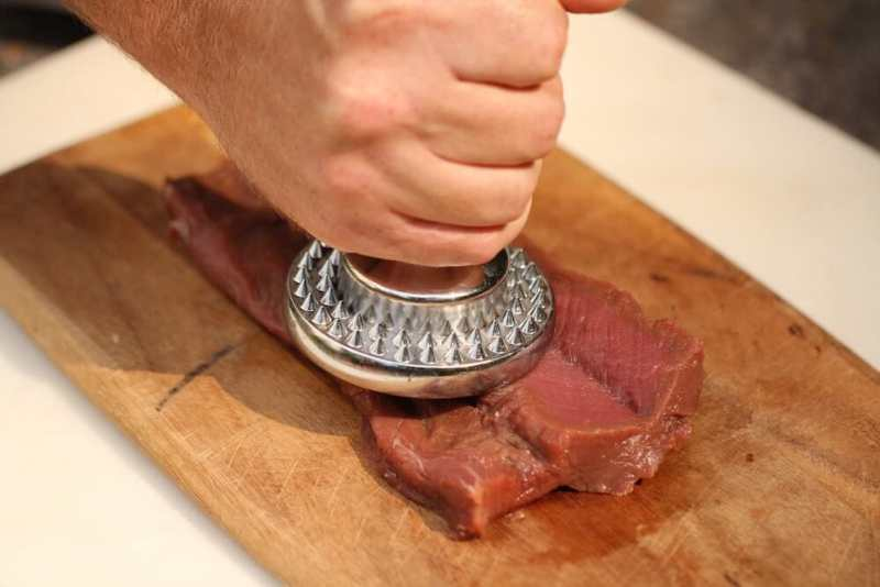 step 4 of the butterfly technique - pounding the venison loin, photo by Stacy Lyn Harris