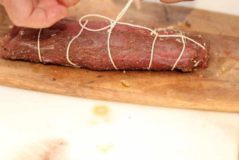 Final step of the trussing technique to stuff venison loins, photo by Stacy Lyn Harris