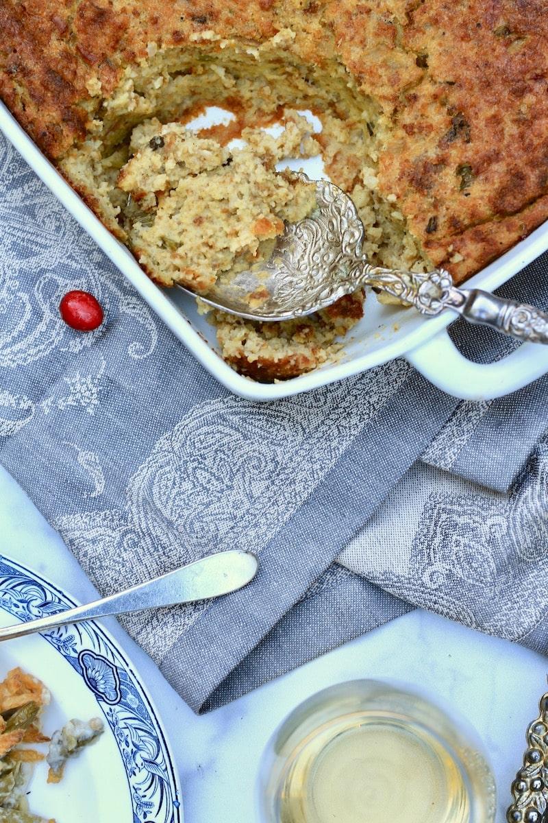 Large Spoonful of Cornbread Dressing in corner of square casserole dish