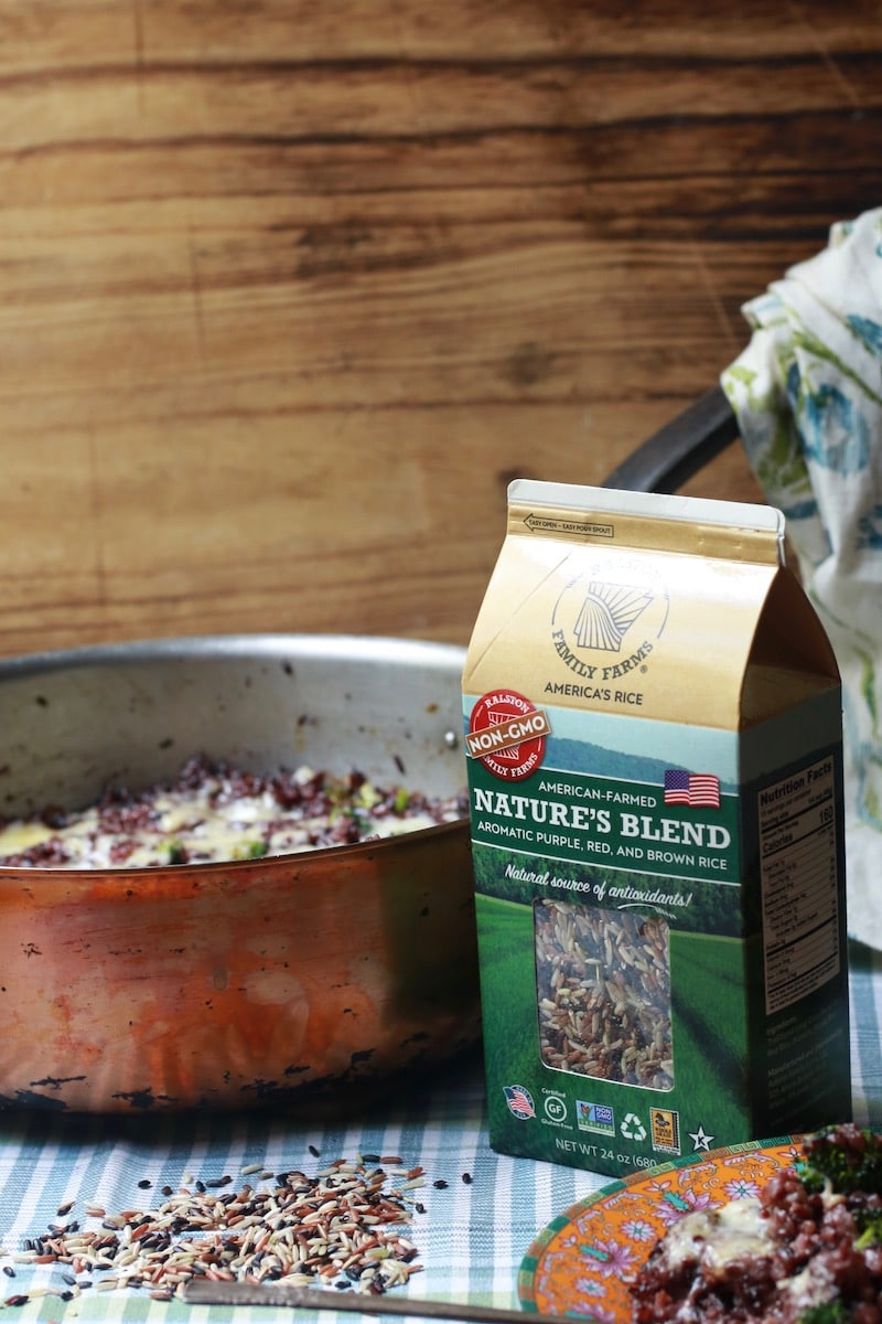 Nature's Blend Wild Rice package with rice on a checked napkin