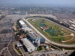 """Aerial view of Hollywood Park racetrack with historic LA Forum in background (Photo: """"Hollywood Park"""" by Doc Searls - originally posted to Flickr as bos-lax-sba_52.JPG. Licensed under CC BY-SA 2.0 via Wikimedia Commons - http://commons.wikimedia.org/wiki/File:Hollywood_Park.jpg#/media/File:Hollywood_Park.jpg)"""