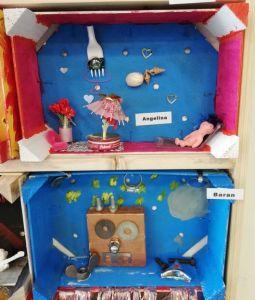 Buntes Diorama in der Obstkiste