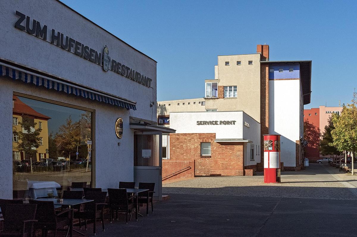 Hufeisenrestaurant und Servicepoint der Siedlung des UNESCO Welterbes