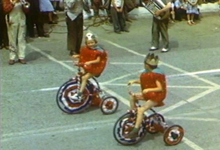 Tricycle-riding fruit in the MIssion Strawberry Festival parade, 1949.