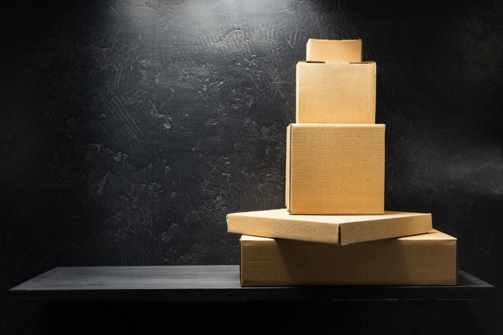 cardboard box on wooden shelf