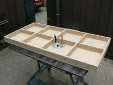 The home made router table bottom view without router
