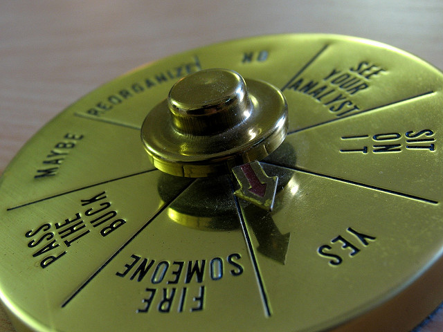 gold sundial decision maker with arrow pointed toward yes