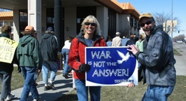 people holding War is Not the Answer sign