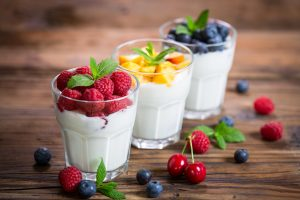 Fresh fruit yogurt with fresh berries and peaches