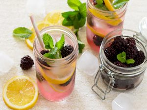 Fruit water. Refreshing summer drink with blackberries, lemon and mint. The concept of healthy and dietary nutrition.