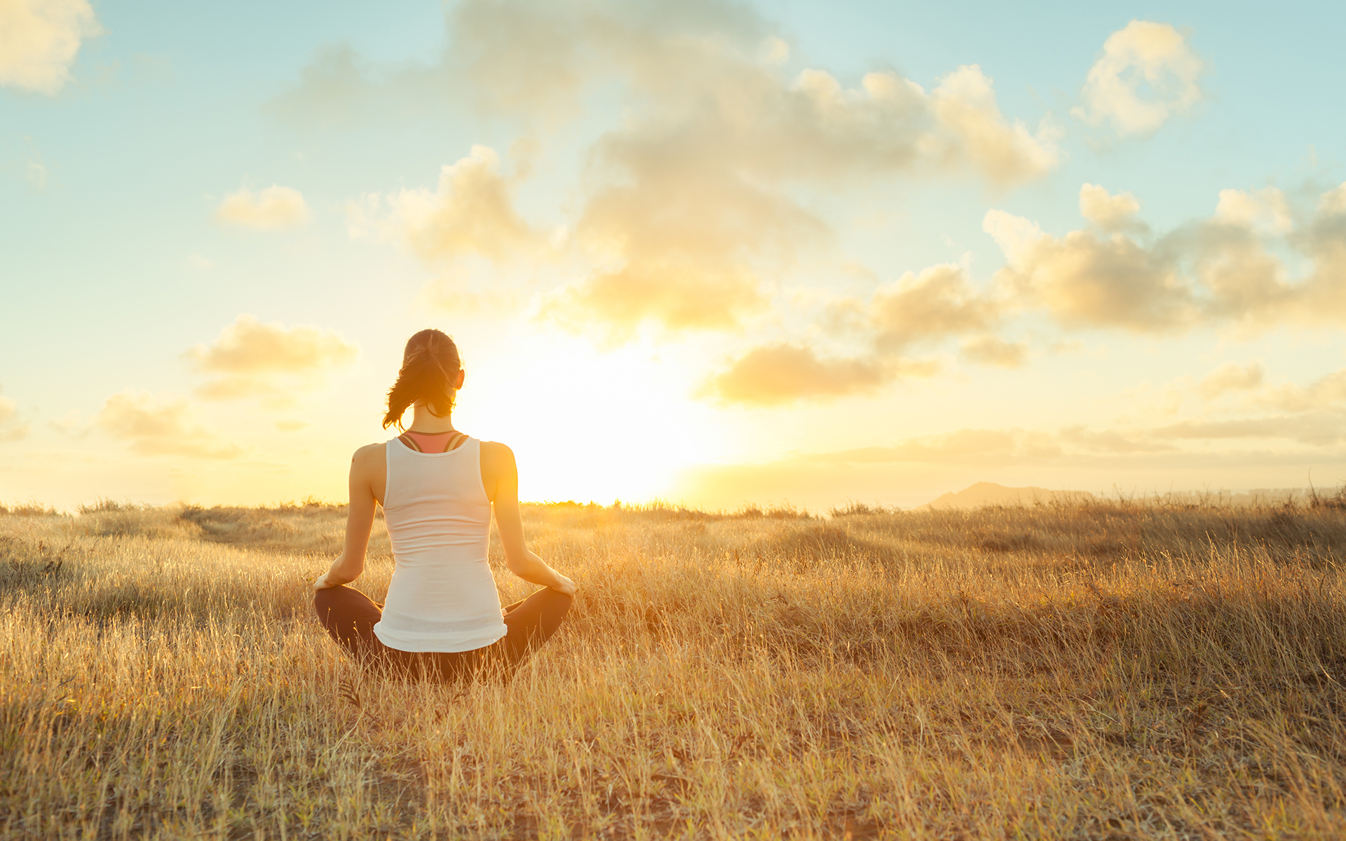 A Guided Meditation for Gathering Your Energy - Woman meditating, yoga, feeling at peace outdoors