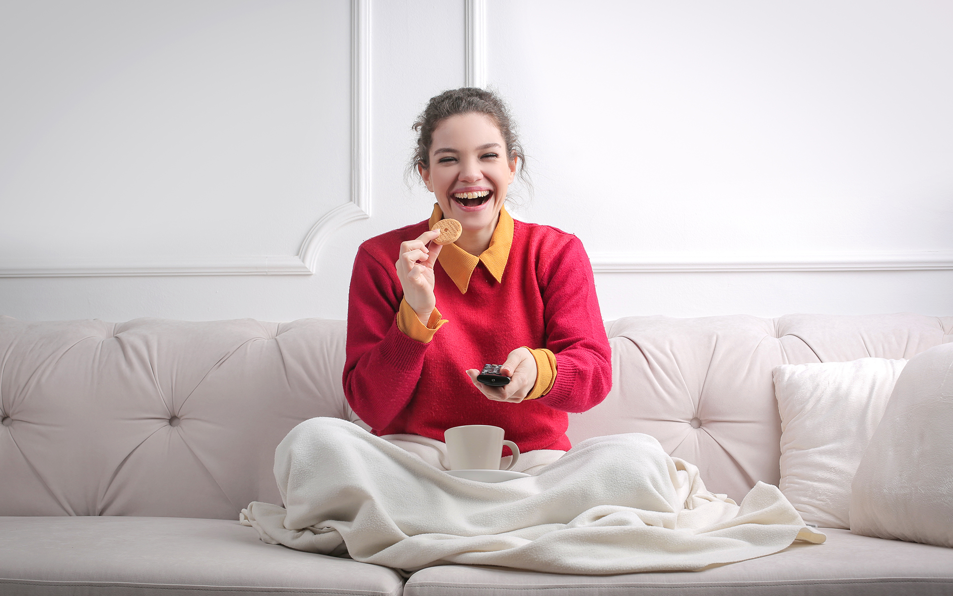 Point of View Podcast Episode 16 - Woman sitting on a couch watching tv with cookies and a cup of tea