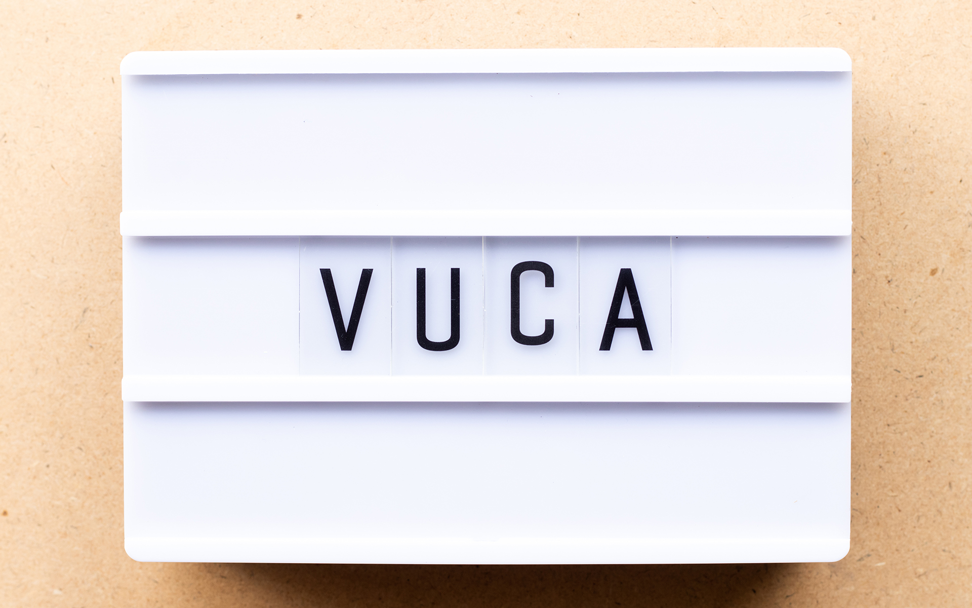You're Overwhelmed But It's Not Your Fault - Lightbox with word VUCA (abbreviation of Volatility, uncertainty