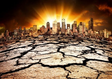 An artist's impression of a post-apocalyptic New York City skyline, with the scorched cracked earth at the forefront and an eerie yellow glow at the background.