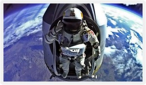 A historical photograph of extreme skydiver Felix Baumgartner, seen here dressed in his pressurised space suit, saluting prior to leaving the high altitude capsule for his record-breaking space dive.