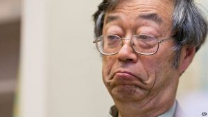 A close-up photograph of a Japanese man presumed to be the original Satoshi Nakamoto.