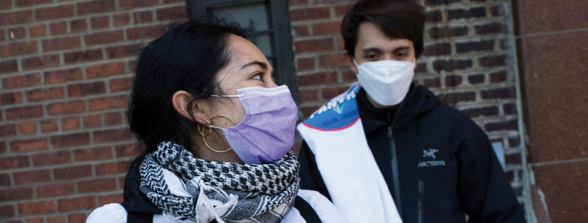 Two people with masks on due to COVID.