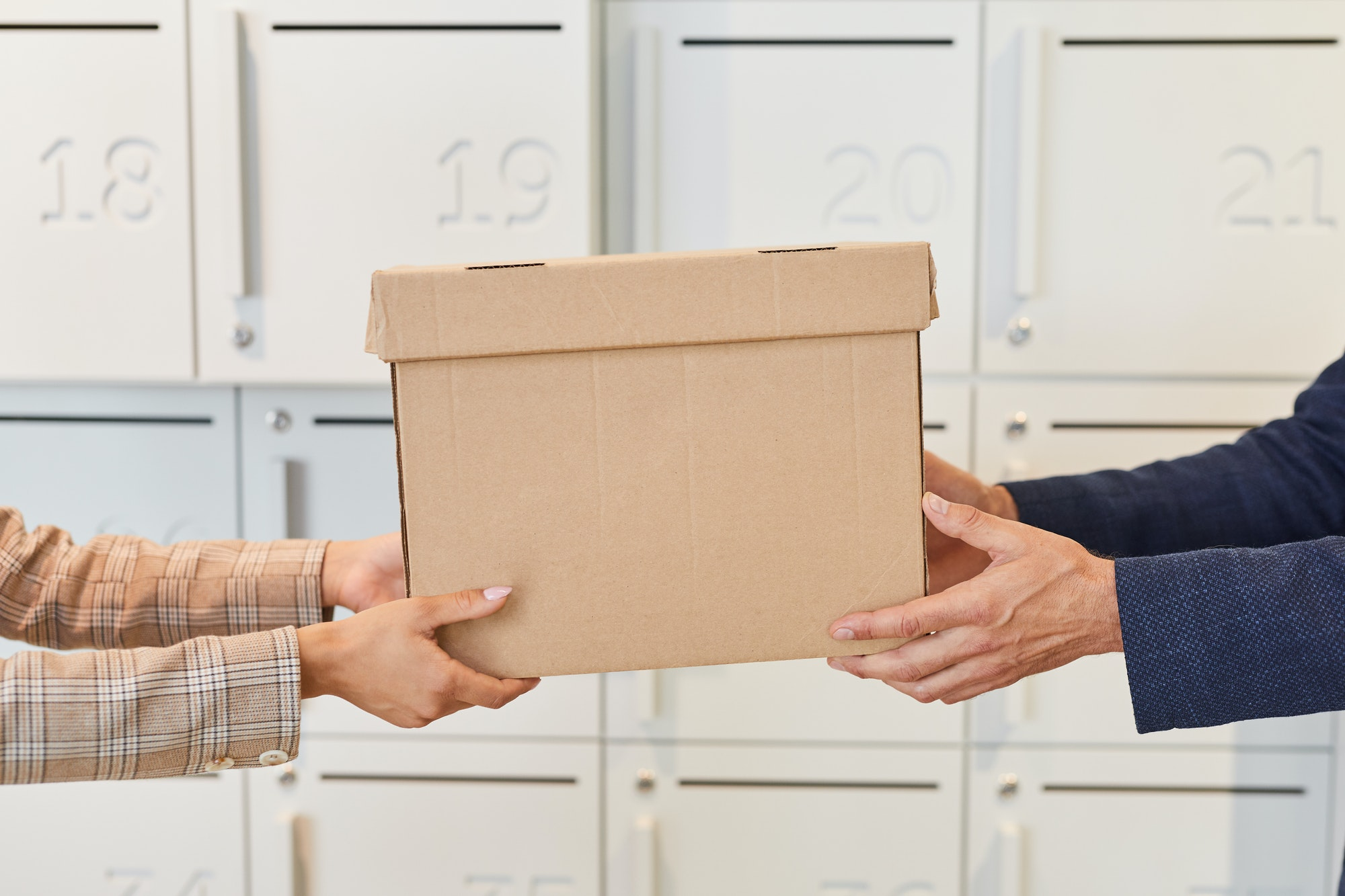 Business People Handing Box