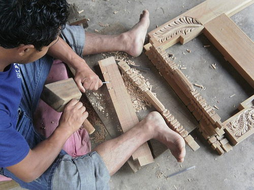 Artisan carving wood to make akhijhyal - the artistic window to Nepal