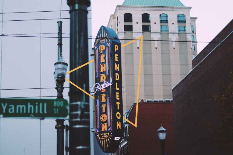 photography of black and yellow signage