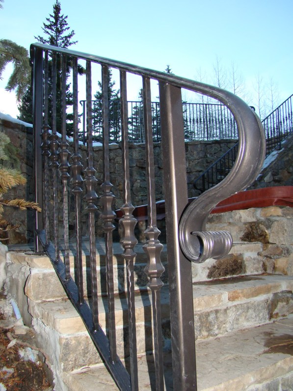 stone staircase with dark grey railing