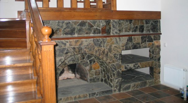 Fireplace under the stairs