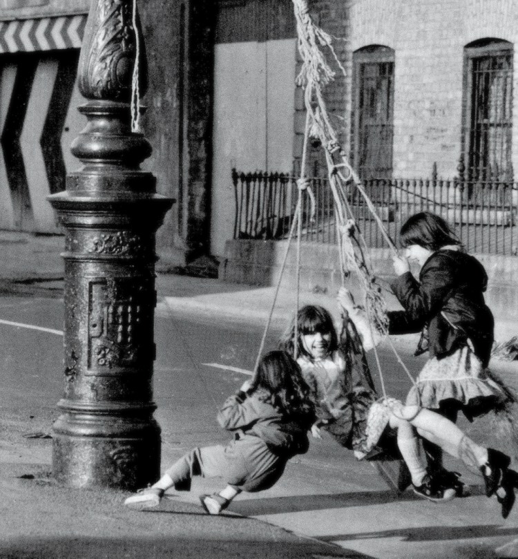 three-girls-spin-around-a-lamp-post-on-a-make-shift-swing-949x1024