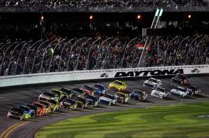 DAYTONA BEACH, FL - FEBRUARY 27:  Denny Hamlin leads the field during the NASCAR Sprint Cup Series Daytona 500 at Daytona International Speedway on February 27, 2012 in Daytona Beach, Florida.  (Photo by Jonathan Ferrey/Getty Images for NASCAR)