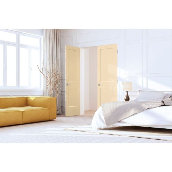 light yellow Logan moulded interior door in bright white bedroom with short yellow couch