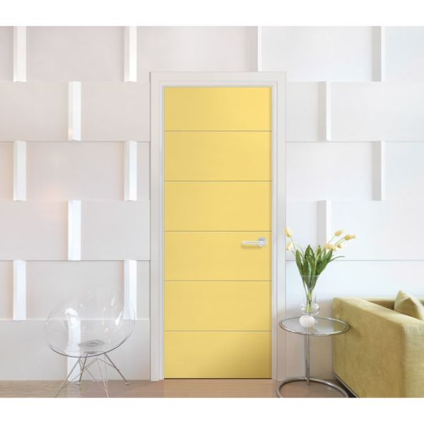 Yellow melrose moulded interior door on white artisitc wall