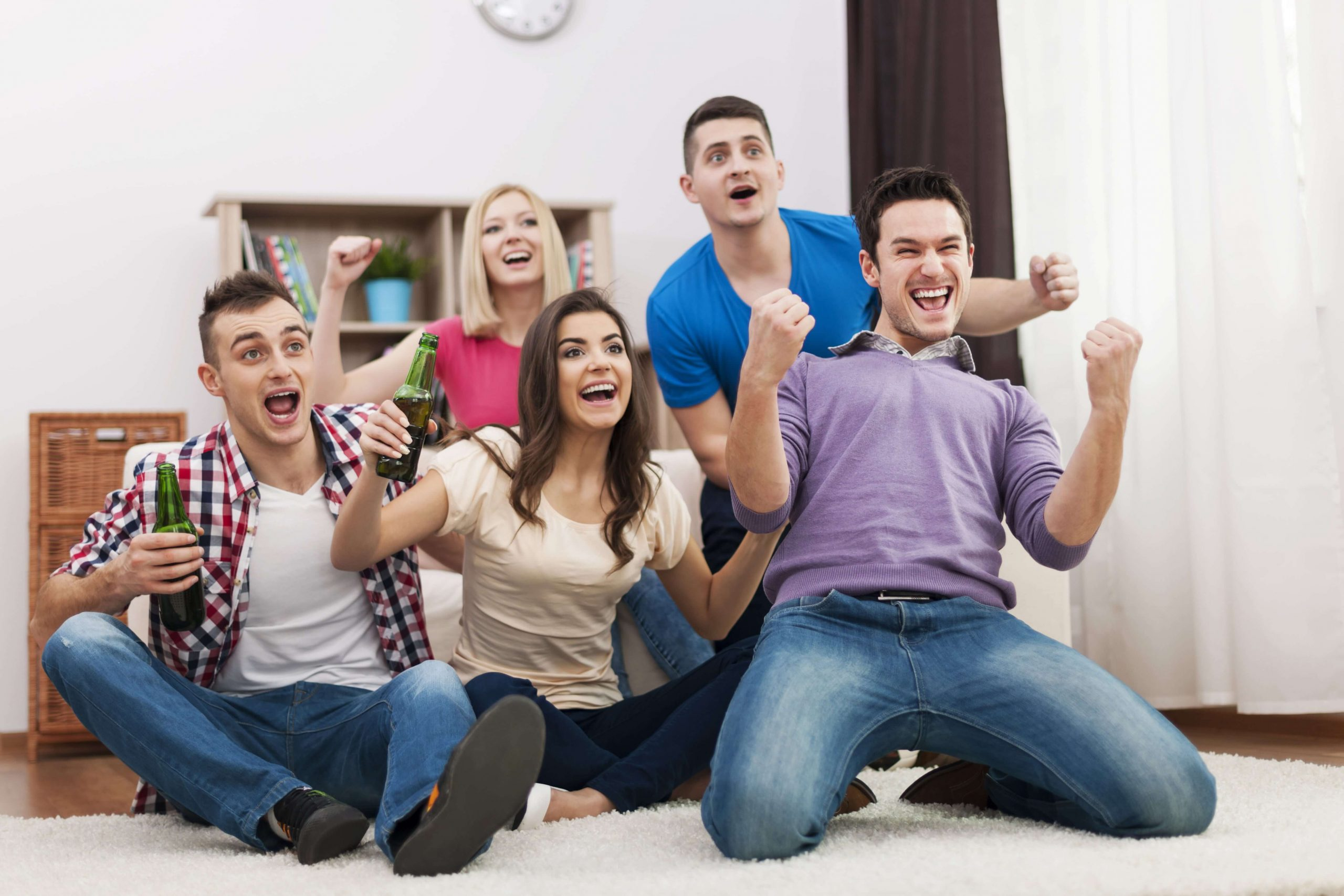 young-friend-watching-tv-and-cheering-soccer-min (1)