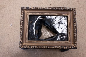 Untitled, picture frame, electrical tape, wheels, 2014