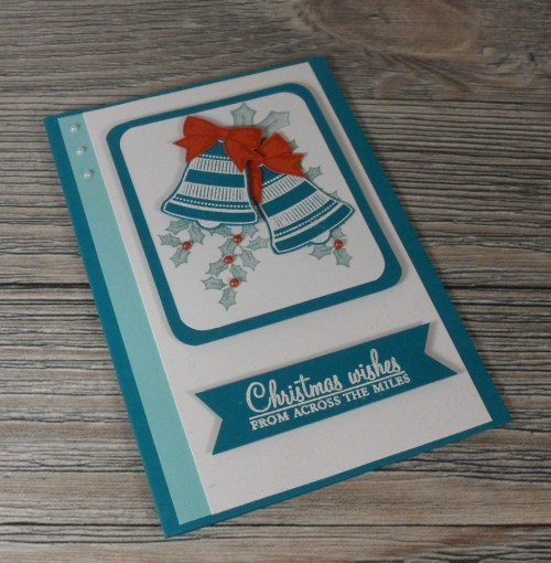 Stampin' Up Seasonal Bells and Holly Berry Happiness stamp sets make a beautiful Christmas card made by Ruth Sollberger.