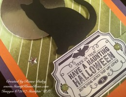 Closeup image of cat punch and Label To Love stamp set image