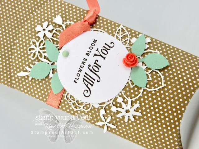 Click here to see how to make a hanging pillow box using the Kraft Pillow Boxes, the Delightfully Detailed Laser-Cut Paper, the Blossom Elements, tags from the Sweet Pins & Tags accessories, the Basics Brads, some coordinating ribbon, and the All That You Are stamp set. I also share tips for positioning the sentiment image on the tag using the Stamparatus tool and vellum. Many of the products I share are retiring. So know that they will only be available until June 3, 2019 or while supplies last. Be sure to watch my video so you can see all my tips and tricks and get the step-by-step directions! #stampyourartout #stampinup - Stampin' Up!® - Stamp Your Art Out! www.stampyourartout.com