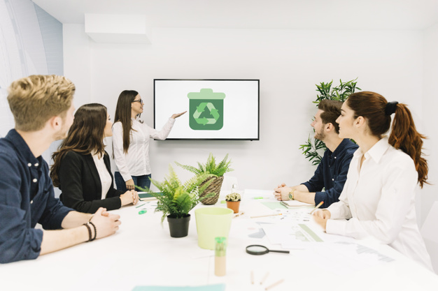 business-partners-looking-female-manager-giving-presentation-with-recycle-icon-screen_23-2147826536