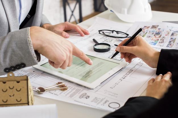businessmen-analyzing-business-plan-tablet_23-2148252119