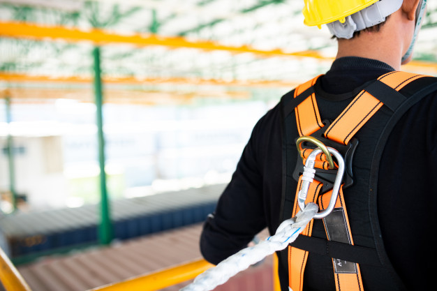 construction-worker-wearing-safety-harness-safety-line-working-construction_28668-75
