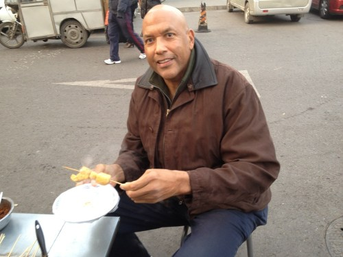 James_trying_out_some_chinese_street_food_-_2012