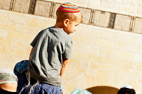 Young boy on shoulders at the Western Wall
