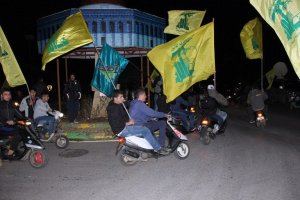 Lebanese Hezobollah supporters waving flags