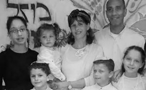 Hadas Mizrahi, a recent widow as a result of terrorism, and family, April 2014.